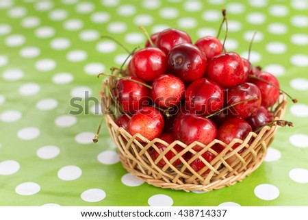 Pile of cherries in the wooden basket