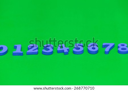 Pile of child toy wooden color letters - stock photo