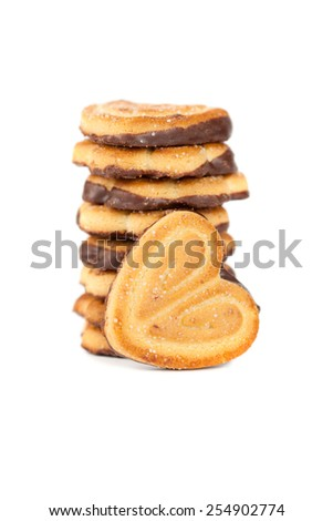 Pile of chocolate chip cookies shaped heart - stock photo