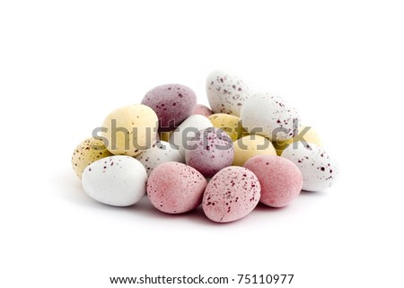 Pile of chocolate easter eggs over a white background - stock photo