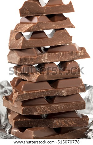 Pile of chocolate in chunks isolated on white.