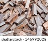 Pile of chooped wood for fire as background - stock photo