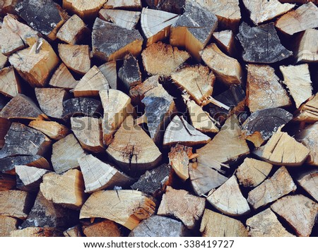 Pile of chopped fire wood, vertical background