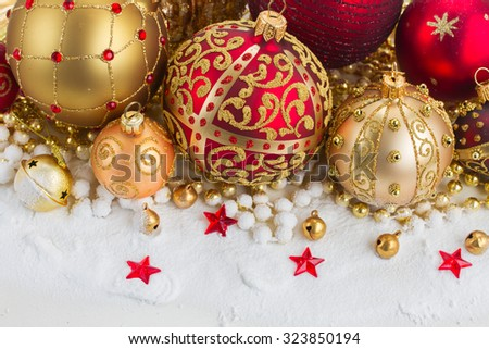 pile of christmas red and golden ball  in snow  - stock photo
