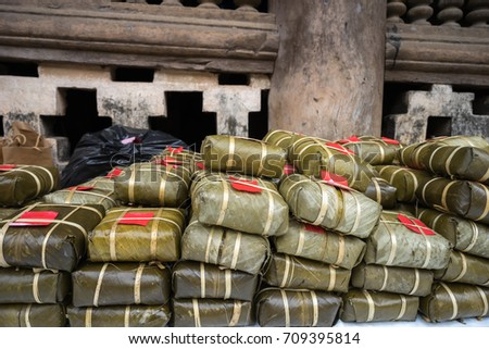 Pile of Chung cakes, Cooked square glutinous rice cake, Vietnamese new year food. Vintage background