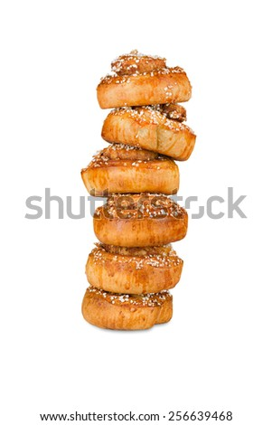 Pile of cinnamon rolls on white, containing clipping mask for easy exchange of background etc. - stock photo