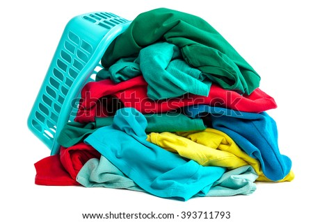 Pile of clothes to wash and a plastic container isolated on white background.