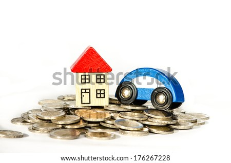 pile of coins, house and car detail image