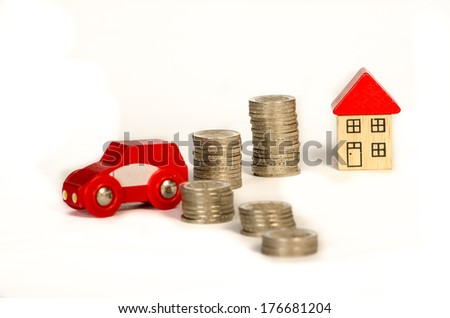pile of coins, house and car detail image - stock photo