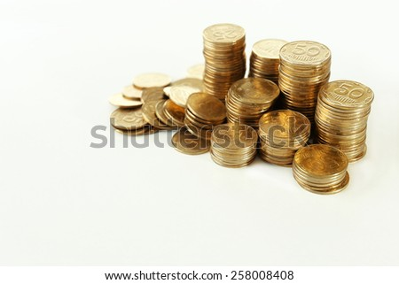 Pile of coins isolated on white