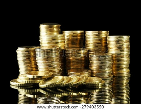 Pile of coins on dark background