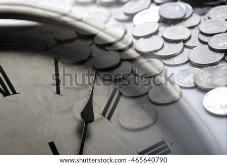pile of coins with clock face close up