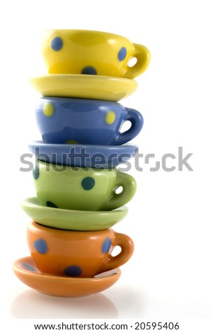 Pile of colored cup and saucers with dots