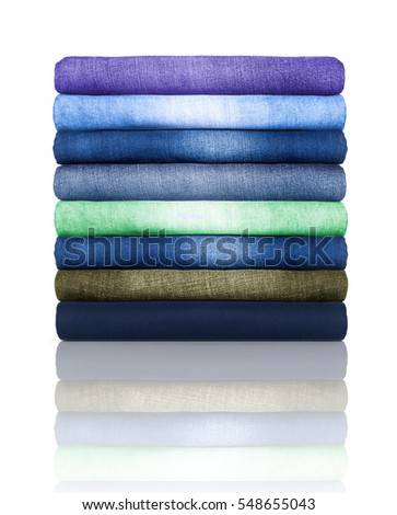 pile of colored jeans on a white background