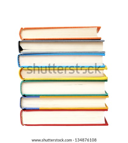 pile of colorful books isolated on white background - stock photo