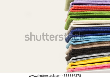pile of colorful bright thick felt pieces on white background
