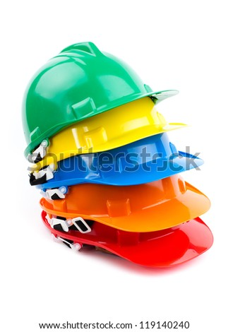 pile of colorful builder safety hardhats - stock photo