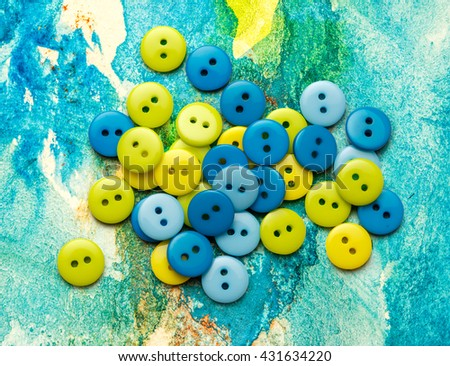 Pile of colorful buttons on colorful background - stock photo