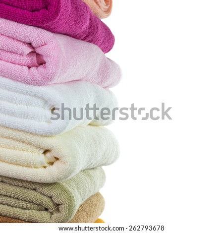Pile of colorful clean towels isolated on white background - stock photo