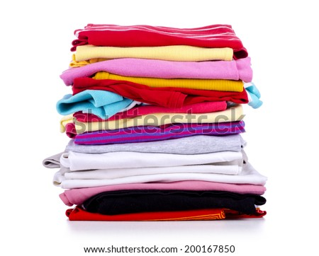 Pile of colorful clothes, isolated white background  - stock photo