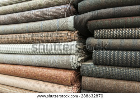 Pile of colorful cotton and wool textile on store