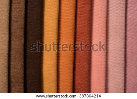 Pile of colorful cotton and wool textile on store - stock photo