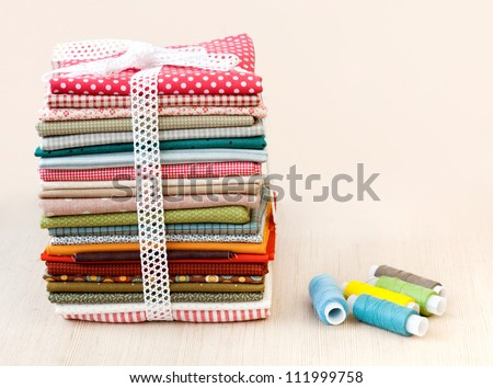 Pile of colorful folded textile - stock photo