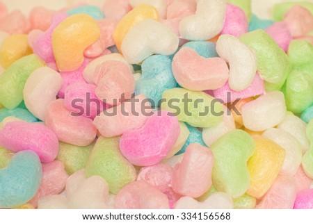 Pile of colorful heart shape cushions - stock photo