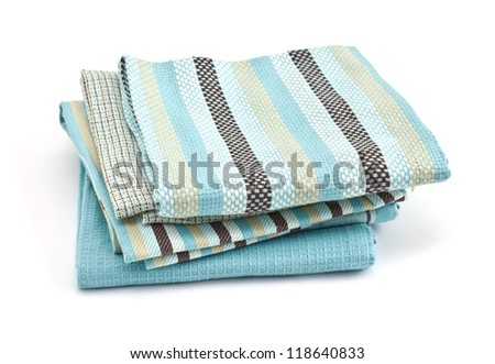 Pile of colorful kitchen towels isolated on white background