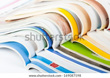 Pile of colorful paper magazines - stock photo