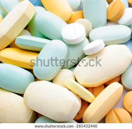 Pile of colorful pills drugs and tablets