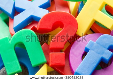 Pile of colorful plastic letters with red question mark - stock photo