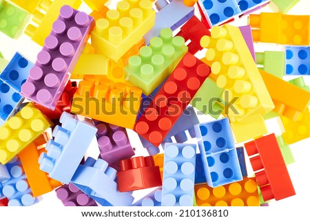 Pile of colorful plastic toy construction bricks as a background compostion - stock photo