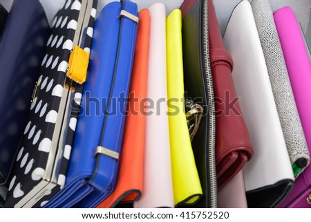 pile of colorful purse isolated on white
