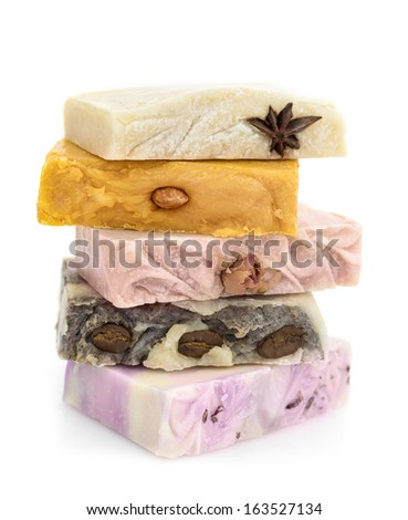 Pile of colorful soap with natural includes  - stock photo