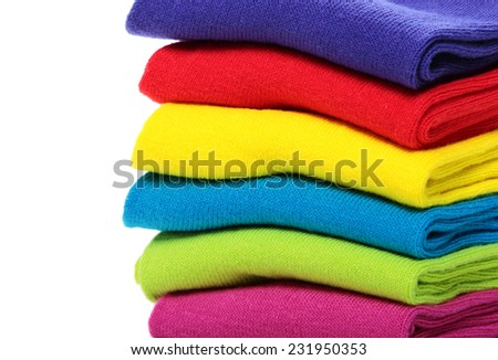 Pile of colorful socks on white background