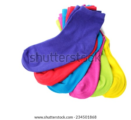 Pile of colorful socks on white background - stock photo