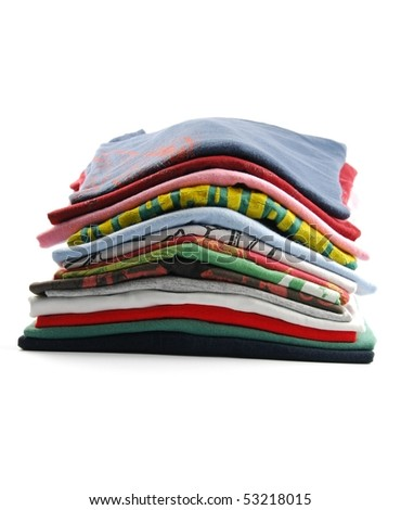 pile of colorful t-shirts isolated on white background - stock photo