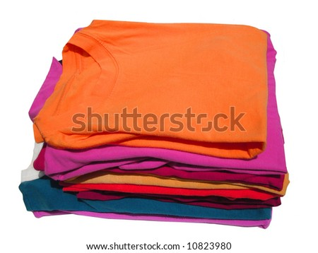 pile of colorful tshirts freshly folded from the laundry
