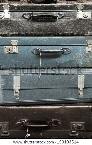 Pile of colorful vintage suitcases - stock photo