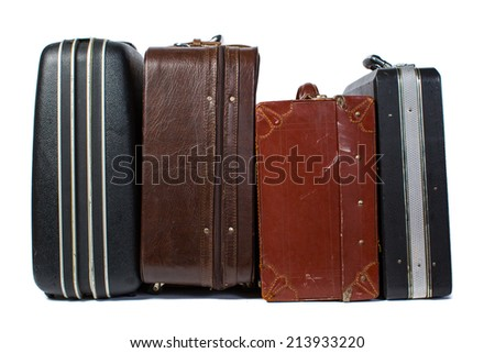 Pile of colorful vintage suitcases. - stock photo