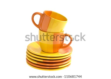Pile of  colourful  cups and saucers isolated on white background - stock photo
