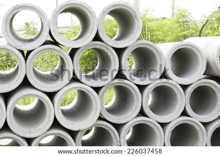 pile of concrete Drainage Pipe on a Construction Site - stock photo