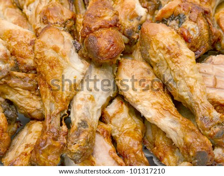 Pile of cooked chicken drumsticks - stock photo