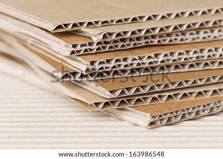 Pile of corrugated cardboard. Shallow DOF, macro shot. - stock photo