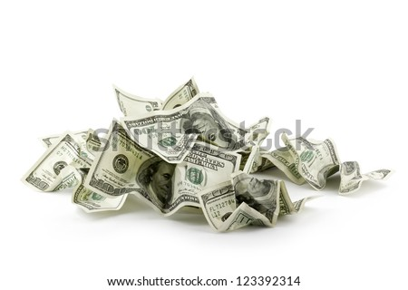 Pile of crumpled money dollar bills overs white background - stock photo