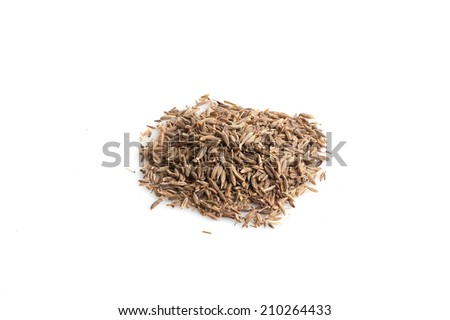 Pile of cumin seeds isolated on white