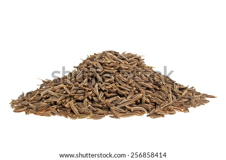 Pile of cumin seeds on a white background - stock photo