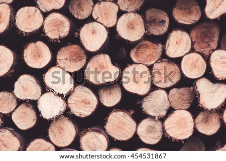 pile of cut wood stump log texture for background