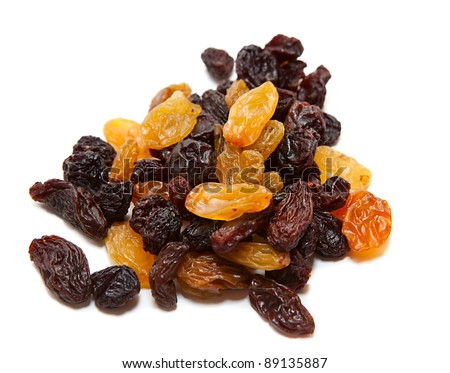 Pile of dark and light raisins isolated on a white background.
